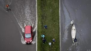 An aerial view of a boat and a car on a flooded street in La Plata on 3 April 2013