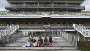 Women on steps at Aintree