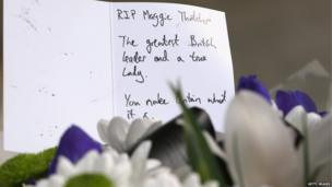 Card and flowers left after the death of Margaret Thatcher.