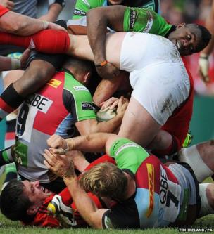 Harlequins' Danny Care and Ugo Monye fight to regain possession of the ball