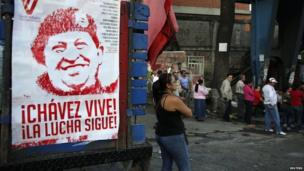 Venezuelans line up to vote in Caracas for a successor to late President Hugo Chavez