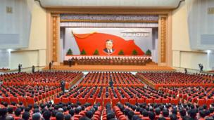 KCNA picture shows attendees at a central report meeting to celebrate the 101st birth anniversary of North Korean founder Kim Il-Sung, in Pyongyang