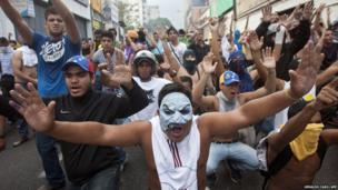 Supporters of Venezuelan opposition presidential candidate Henrique Capriles protest in Caracas