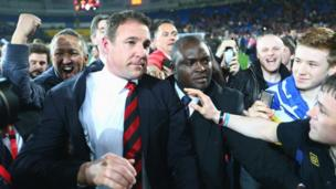 Cardiff City manager Malky Mackay is mobbed by fans