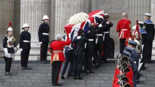 The coffin of Baroness Thatcher is carried aloft by members of the armed forces prior to her funeral.
