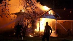 A firefighter tackles a blaze at a property near the fertiliser plant.