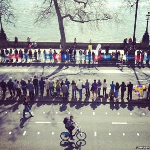 Waiting for the marathon runner by Somerset House. Photo: lomokev