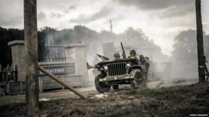 WWII re-enactment featuring American troops