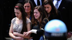 Mourners walk out of St Joseph's Catholic church after the funeral service for Krystle Campbell in Medford, Massachusetts, 22 April