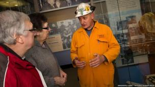 A miner guide with visitors, pictured in 2012