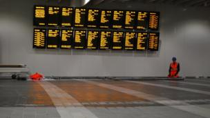 Information boards in the new concourse at New Street station