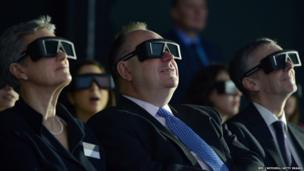 Scotland's First Minister Alex Salmond wearing 3D glasses