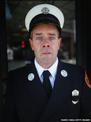 Medford Fire Department Captain Tom Brennan poses after the funeral for Krystle Campbell, who was one of three people killed in the Boston Marathon bombings