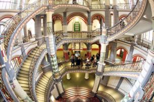 Visitors stand in the staircase of the restored former Prussian justice palace in Halle an der Saale, eastern Germany