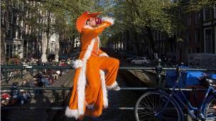 Man dressed in orange in Amsterdam, NL (29 April 2013)