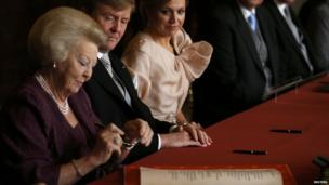 Queen Beatrix of the Netherlands, Prince Willem-Alexander of the Netherlands, and Princess Maxima of the Netherlands (30 April 2013)
