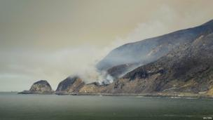 The Springs Fire works its way to the Pacific Coast Highway near Port Hueneme, 3 May