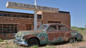 An old trading post and abandoned car