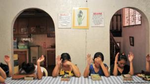 Single mothers attend a religious function at Nazareth House in Manila, Philippines