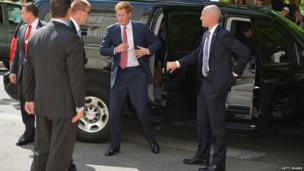 Prince Harry with security