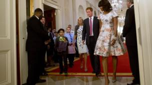 Michelle Obama with Prince Harry and children