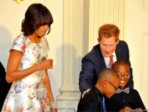 Prince Harry with First Lady Michelle Obama and children who are making presents for their mothers at White House