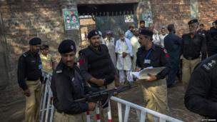 Police outside a polling station in Lahore