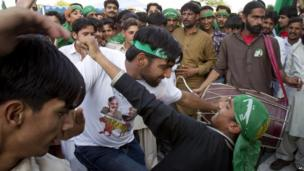 "Supporters of Pakistan""s former Prime Minister Nawaz Sharif celebrate the victory of their leader in Islamabad, Pakistan"