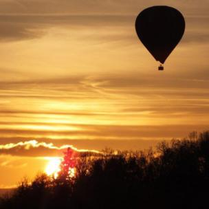 Balloon at sunset