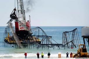 Workers begin the demolition of the remnants of the Jet Star roller coaster in New Jersey