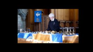 Woman arranging bells in a church