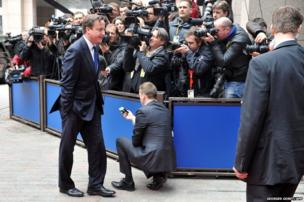 British Prime Minister David Cameron arrives for the European Council meeting at the EU headquarters in Brussels