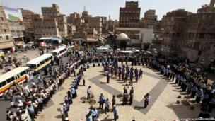 People watch a performance by boys and girls of the Scouts in Sanaa