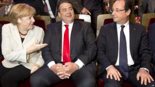 German Chancellor Angela Merkel (l), German Social Democratic Party (SPD) leader Sigmar Gabriel (c) and French President Francois Hollande , 23 May