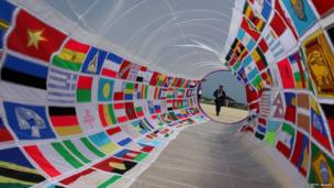 A kite decorated with national flags and measures two metres tall and nine metres long.