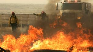 Firefighters fight the blaze at a horse ranch near Los Angeles, California 2 June 2013