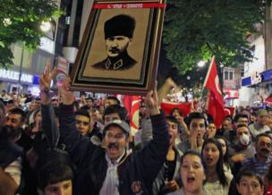 Thousands of Turkish protesters, holding national flags and portraits of Turkey's founder Mustafa Kemal Ataturk, march in Turkish capital, Ankara.