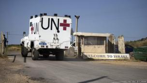 Peacekeepers of the United Nations Disengagement Observer Force (UNDOF) cross the Quneitra crossing from Syira into Israel