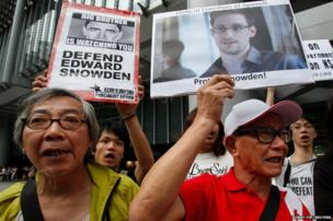 Protesters supporting Edward Snowden, a contractor at the National Security Agency (NSA), chant slogans before marching to US Consulate in Hong Kong