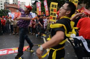 Chicken farmers throw rotten eggs during a demonstration outside the Council of Agriculture in Taipei