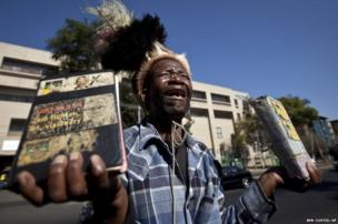 Well-wisher Daniel Sello cries out his thanks to Nelson Mandela in front of the hospital where he's being treated.