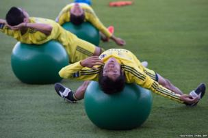 Japan's footballers exercise during a training session