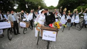 Bride and Groom Alfreda O'Brien and Ciaran Kavanagh take part in the 20th Annual Bloomsday Messenger Bike Rally in Dublin city centre before they tie the knot today