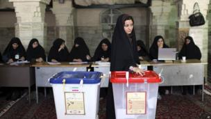 Iranian woman casts vote at polling station in Qom. 14 June 2013