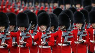 Foot Guards march to the Horse Guards Parade, as part of the Trooping the Colour parade, in London