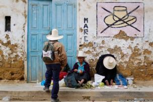 Andean women sell vegetables in a street in Celendin
