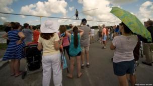 People watch as high-wire walker Nik Wallenda practises