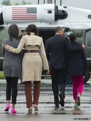 US President Barack Obama arrives with his family at Belfast International Airport