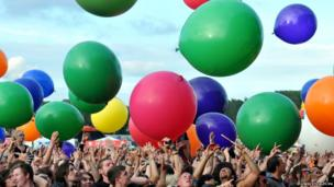 The crowd react as giant balloons are released at the Download Festival
