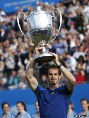 Andy Murray holds up the trophy after his win against Marin Cilic of Croatia